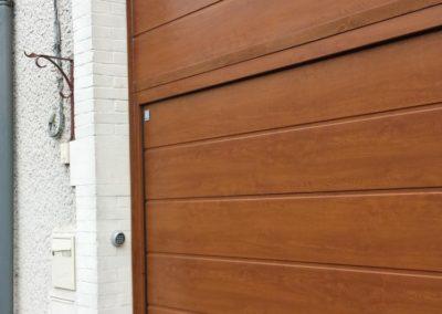 porte de garage sectionnelle décor chêne doré 2